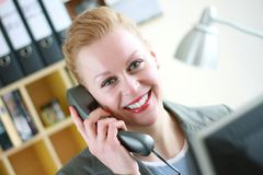 Receptionist 2. Image taken of a Female receptionist with headphones Stock Photos