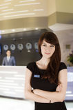 Receptionist. Similing in front of the  hotel reception Royalty Free Stock Photography