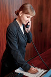 Receptionist answering the call Royalty Free Stock Image