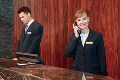 Receptionist answering the call Stock Photo