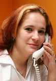 Receptionist answering her company?s phone Stock Photo