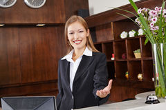 Receptionist behind desk in hotel Stock Photos