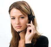 Receptionist at call center. Young beautiful girl with headphones with microphone stock photos