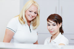 Receptionist with doctor at reception Stock Photo