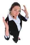 Receptionist with earphones Stock Image