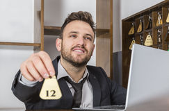 Receptionist Giving the Key Stock Photo