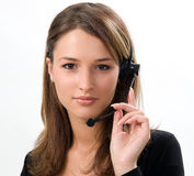 Receptionist with headset. Beautiful smiling girl with headset on white background royalty free stock photography