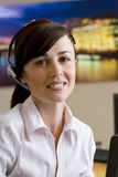 Receptionist with headset, smiling, portrait Stock Photo