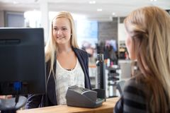 Receptionist Helping Customer at Beauty Salon Stock Photography