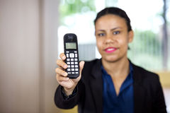 Receptionist Holding Cordless Phone Stock Photo