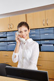 Receptionist in hospital taking call Royalty Free Stock Photography