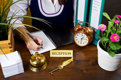 Receptionist of hotel check in Royalty Free Stock Photo
