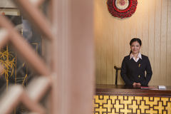 Receptionist at Hotel Front Desk Stock Image