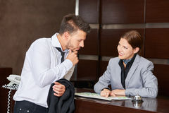 Receptionist in hotel giving advice to guest Royalty Free Stock Photo