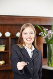 Receptionist at hotel offering key card Stock Image