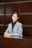 Receptionist at hotel reception stock photography