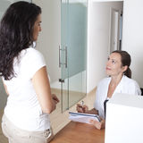 Receptionist making an appointment Royalty Free Stock Photography
