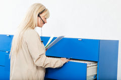 Receptionist with Medical Records Stock Photos