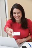 Receptionist Offering Name Tag In Office Royalty Free Stock Photo