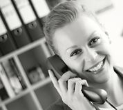 Receptionist on the phone Royalty Free Stock Images
