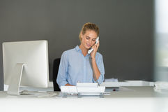 Receptionist on phone Royalty Free Stock Photography