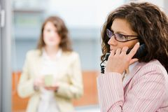 Receptionist receiving phone calls Royalty Free Stock Images