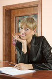 Receptionist smiling Royalty Free Stock Photography