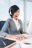 Receptionist sul lavoro Immagini Stock