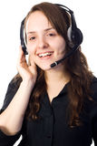 Receptionist talking with a head-set. An attractive and smiling auburn receptionist talking with a head-set. White background Stock Photos