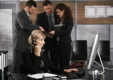 Receptionist talking on headset Royalty Free Stock Images