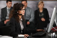 Receptionist talking on headset Royalty Free Stock Photo