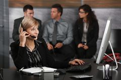 Receptionist talking on phone Royalty Free Stock Image