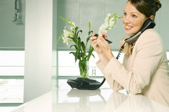 A receptionist talking on the telephone Stock Image