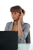 Receptionist wearing head-set Stock Image