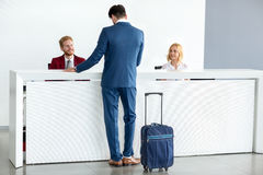 Receptionist wish welcome to guest Stock Image