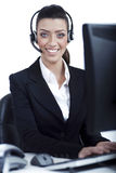 Receptionist at work with headset Royalty Free Stock Photo