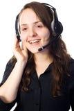 Receptionnist die met een hoofdtelefoon spreekt Stock Foto's
