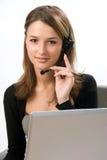 Receptionnist met hoofdtelefoon Royalty-vrije Stock Afbeeldingen