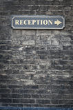 Receptions sign on brick wall Stock Photo