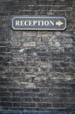 Receptions sign on brick wall. Reception sign on black brick wall Stock Photo