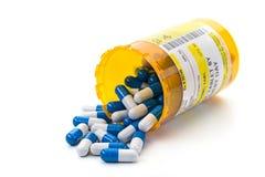 Receptläkarbehandling i apotekpreventivpillersmå medicinflaskor Royaltyfri Foto
