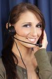 Receptor de cabeza del ordenador de la muchacha, teléfono Foto de archivo libre de regalías