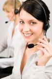 Receptor de cabeza del teléfono del centro de atención telefónica de la mujer del servicio de atención al cliente Imagen de archivo