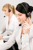 Receptor de cabeza del teléfono del centro de atención telefónica de la mujer del servicio de atención al cliente Imágenes de archivo libres de regalías