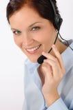 Receptor de cabeza del teléfono del centro de atención telefónica de la mujer del servicio de atención al cliente Foto de archivo