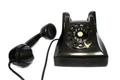 Receptor de teléfono negro pasado de moda con la cuerda o Imagenes de archivo