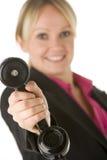 Receptor de telefone da terra arrendada da mulher de negócios Fotos de Stock Royalty Free
