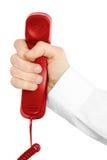 Receptor de telefone vermelho com mão Imagem de Stock
