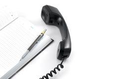 Receptor y cuaderno de teléfono imágenes de archivo libres de regalías