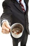 Recesión - el Panhandling del hombre de negocios Fotografía de archivo libre de regalías